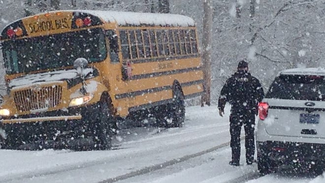 An Eastern York School District bus is stranded on Gun Club Road in Lower Windsor Township during Tuesday's snowstorm.