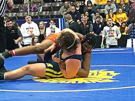 Brighton's Colby Ford (in the orange) wins his 285-