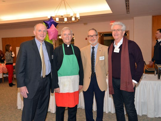 Bloomfield Township Supervisor Leo Savoie (left) with Monsignor Anthony Tocco, Bloomfield Hills City Manager Jay Cravens and Bloomfield Hills City Commissioner Michael Dul.