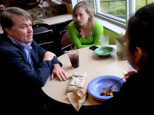 David Rowe, president of Centenary College of Louisiana, speaks with students Ashley White, center, and Taylor Le Moal in the cafeteria Friday about Thursday night's shooting on campus.