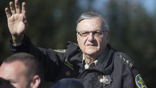Maricopa County Sheriff Joe Arpaio waves to people gathered along the parade route during the Fiesta Bowl Parade on Jan. 2, 2016, in Phoenix. Arpaio lost his bid for a seventh term after nearly a quarter-century as sheriff and a career of more than 50 years in law enforcement.
