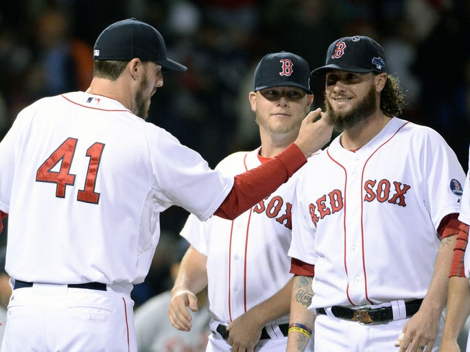Red Sox pitcher John Lackey tweaks the beard of catcher Jarrod Saltalamacchia during player intros before Game 1 of the American League Championship Series against the Tigers at Fenway Park.