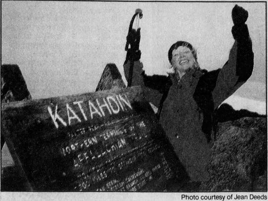 Jean Deeds celebrates the completion of her Appalachian Trail trek.