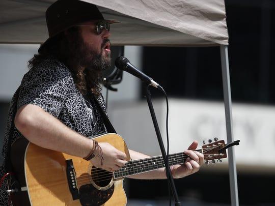 Benjamin Olson performs in Houdini Plaza for Lunchtime Live! in downtown Appleton in 2017.