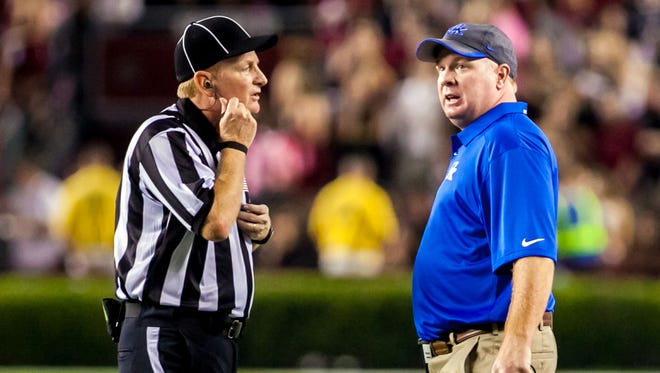 Kentucky Wildcats head coach Mark Stoops disputes a call against the South Carolina Gamecocks in the second quarter at Williams-Brice Stadium.