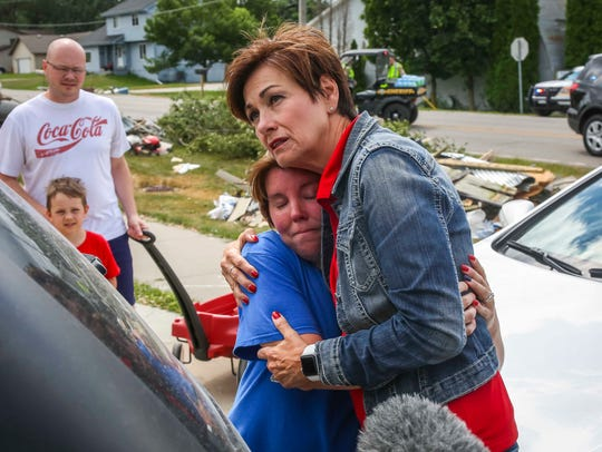 Iowa Gov. Kim Reynolds hugs Holly Manning of Bondurant during a tour of the cleanup in Bondurant, Iowa, Friday, July 20, 2018, after a tornado slashed through the town Thursday afternoon.