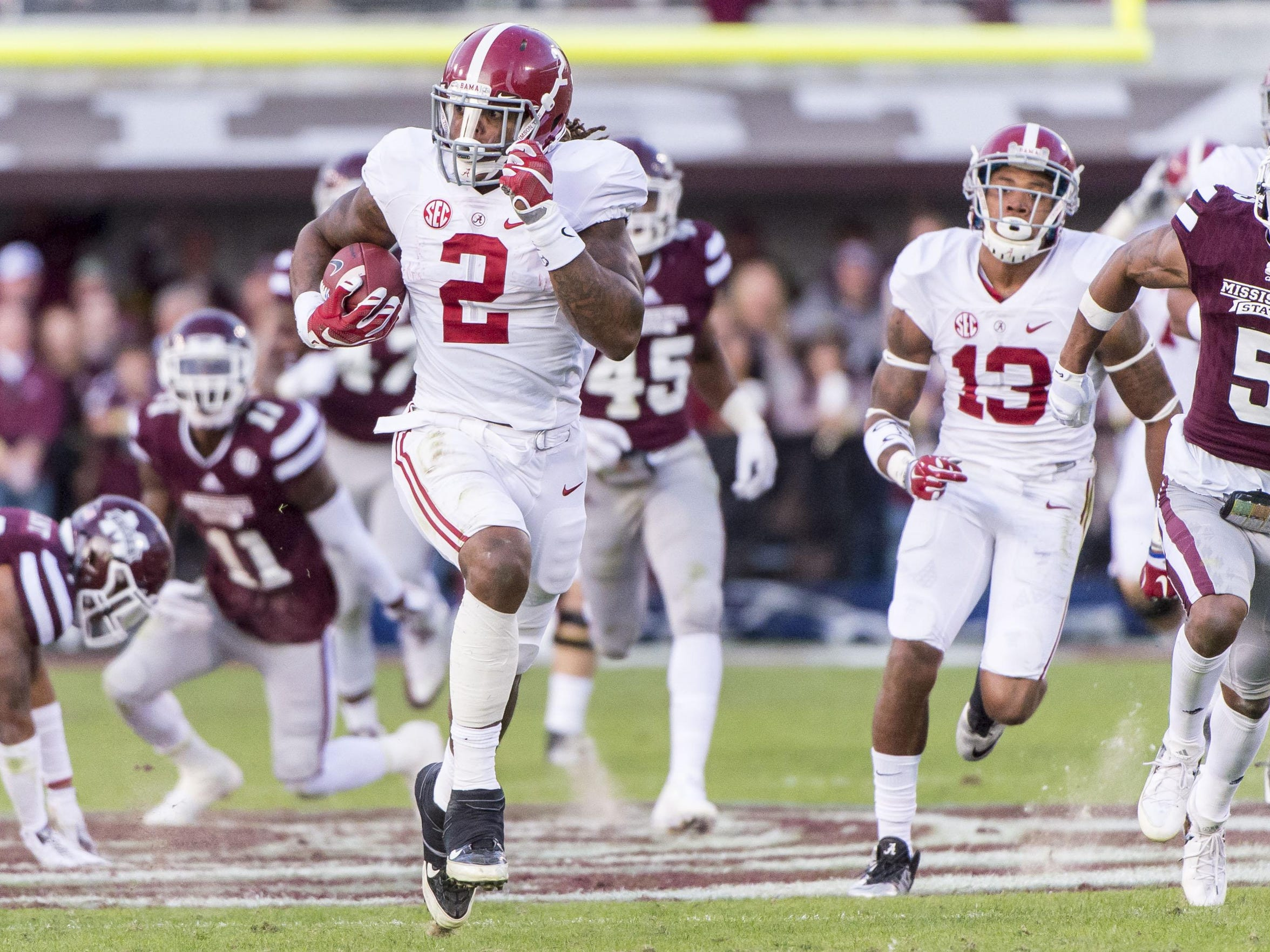 Alabama running back Derrick Henry takes off on a 74-yard touchdown run during the second quarter against Mississippi State on Saturday at Davis Wade Stadium in Starkville, Miss.
