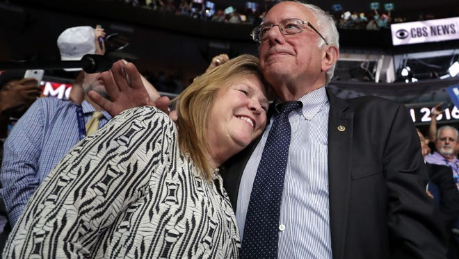 Sen. Bernie Sanders embraces his wife Jane O'Meara Sanders after the Vermont delegation cast their votes during roll call on the second day of the Democratic National Convention at the Wells Fargo Center, July 26, 2016 in Philadelphia, Pennsylvania.