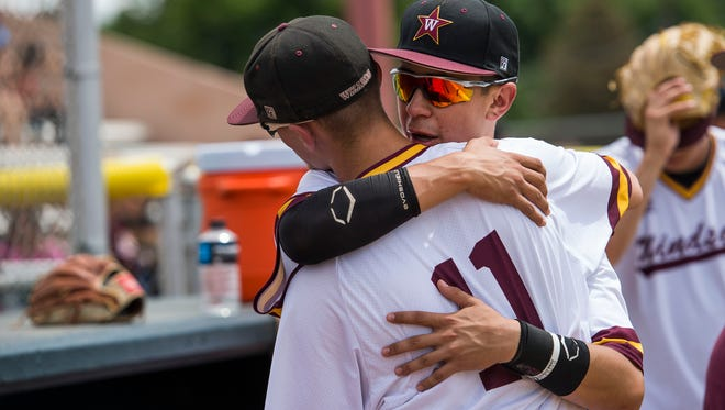 Windsor High School senior right fielder Jake Barker (11) hugs senior catcher teammate Keegan Vialpando (20) after a loss to Valor Christian High School in a state baseball playoff game on Tuesday, May 29, 2018, at All-City Stadium.