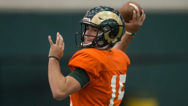CSU quarterback Collin Hill throws a pass during an Aug. 25 practice. Hill, a true freshman, could make his first start for the Rams on Saturday against Northern Colorado, coach Mike Bobo said Tuesday.