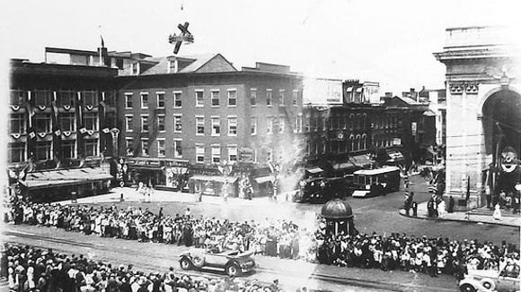 Still another parade, this one in the 1930s.  The cigar store is gone, and so is Punch.