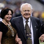 New Orleans Saints owner Tom Benson poses for a photo with his wife Gayle Benson and his granddaughter, co-owner Rita Benson LeBlanc, before an NFL football game against the Minnesota Vikings in New Orleans, Sunday, Sept. 21, 2014. (AP Photo/Bill Haber)
