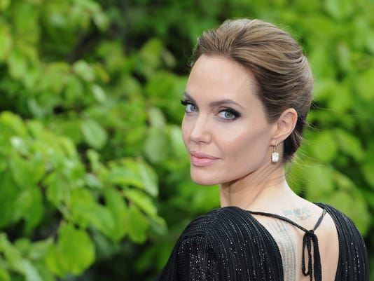 """FILE Angelina Jolie Has Surgery To Remove Ovaries """"Maleficent"""" Costume And Props Private Reception - Red Carpet Arrivals"""