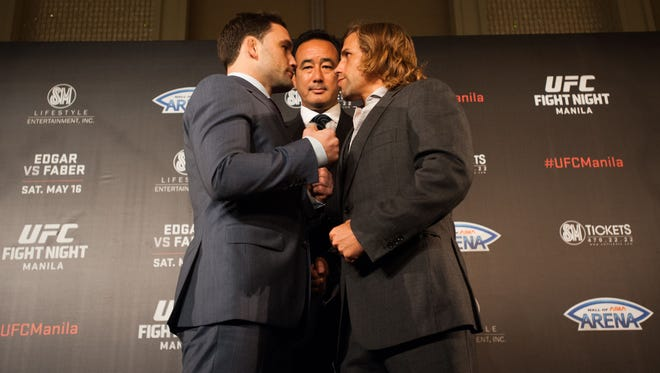 Frankie Edgar and Uriah Faber face off during a March 10 news conference in Manila, Philippines.