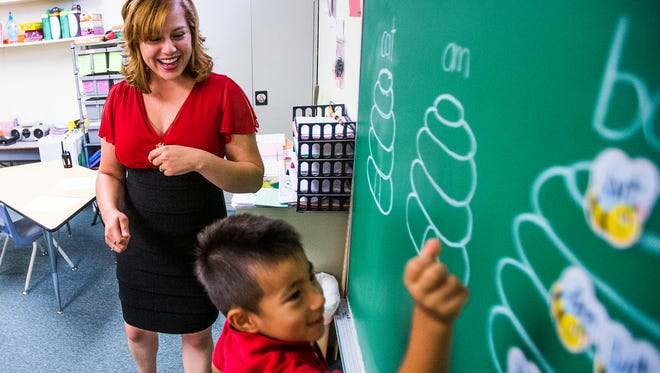 Kindergarten teacher Tisha Alvarez observes Yamato Ruy at Crown Charter School, which in 2014 was the top-scoring charter school in Maricopa County.