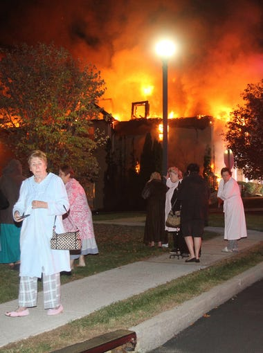Senior citizens that were evacuated from their burning