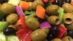 Crunchy bell peppers, celery and onion join olives