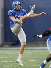 Memphis Tigers punter Tom Hornsey (43) punts during the second half against the UCF Knights in November 2013.