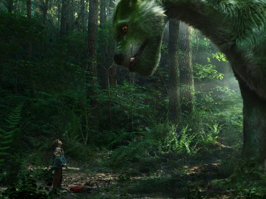 "Boy meets furry friend in ""Pete's Dragon."""