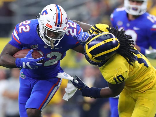Florida's Lamical Perine holds off Michigan's Devin
