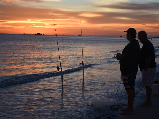 In this file photo, Hunter Bogg fishes while waiting