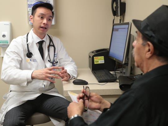 Dr. Nguyen, a third-year resident in UC Riverside's Family Medicine  Residency program, talks to his patient, Antonio Ascensio, at a clinic run by UCR School of Medicine in affiliation with Desert Regional Medical Center in Palm Springs, Calif., February 1, 2018. UCR created the Family Medicine Residency program in 2012 as one way to address the physician shortage that plagues the Coachella Valley. The program will graduate its first seven students this year, six of whom will remain in the desert.