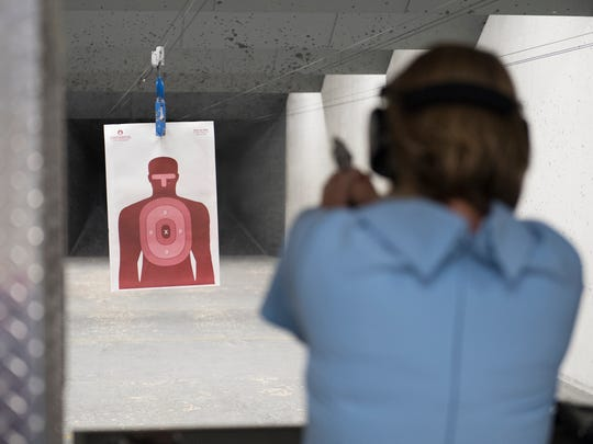GOP Candidate Catherine Templeton shoots at a target