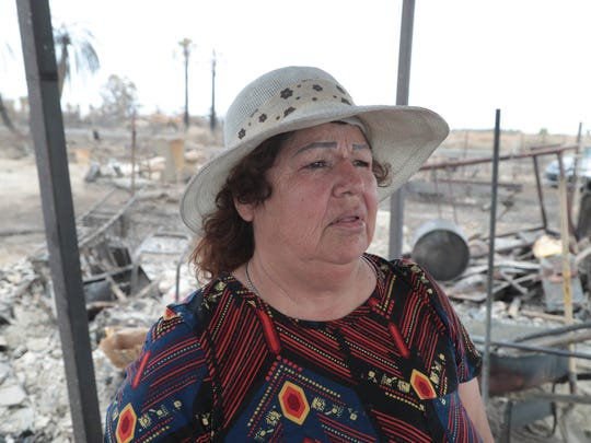 Margarita Armijo stands in the wreckage of her burned home on the Torres-Martinez Reservation, July 31, 2018.