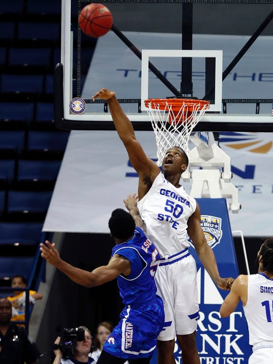Georgia State forward Jordan Tyson (50) tries to block a shot by Texas-Arlington guard Kaelon Wilson (5) in the first half of the the Sun Belt Conference NCAA college basketball championship game in New Orleans, Sunday, March 11, 2018. (AP Photo/Gerald Herbert)