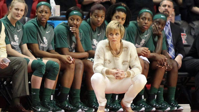 Baylor Lady Bears head coach Kim Mulkey watches the game with the Texas Tech Lady Raiders at United Supermarkets Arena.