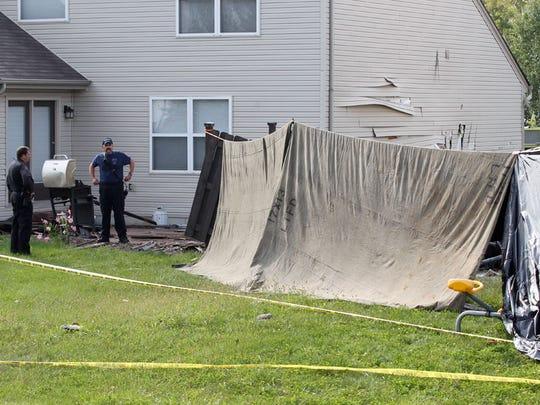 Quiet neighborhood shaken by small-plane crash