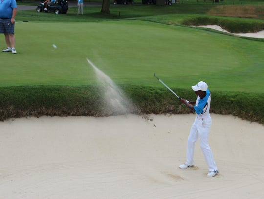 Blasting the ball out of a bunker at The Country Club