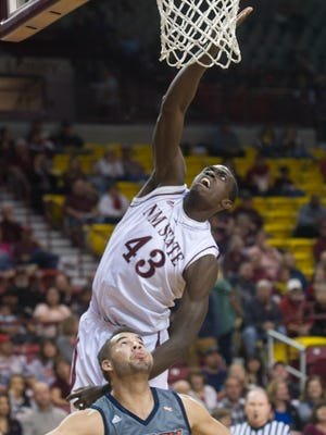 New Mexico State's Pascal Siakam tips the ball in over Texas-Rio Grande Valley's Dakota Slaughter  during Saturday's WAC game at the Pan American Center.