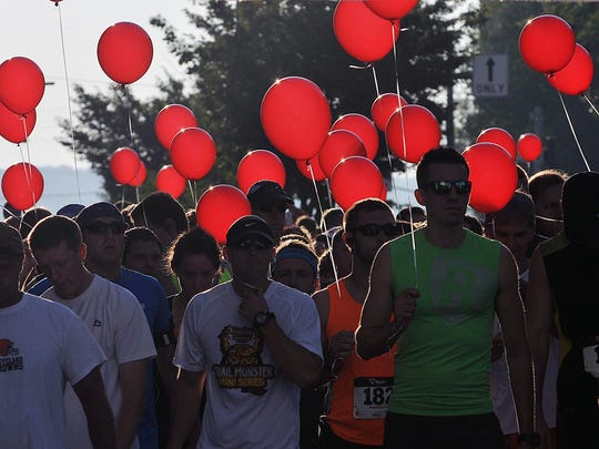 Red balloons, a message supporting drug abuse and prevention, await to be released at the start of the Spherion Mid-Ohio 13ER and 5K fun run in 2015.