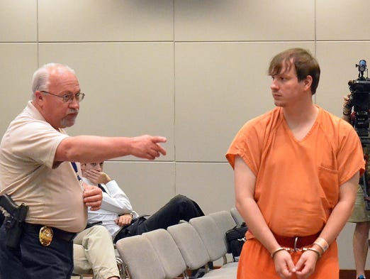 Clayton Kelly looks into the audience as he exits his hearing Thursday in Madison. Kelly allegedly photographed U.S. Sen. Thad Cochran's wife in a nursing home and used the photos in a political video.