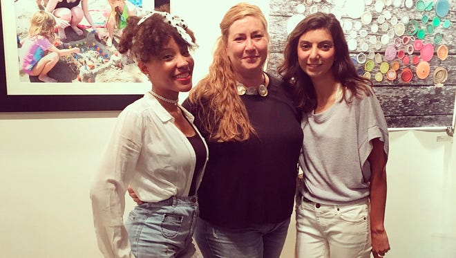 """Arleen Thaler, center, pictured with the two guest artists in her show, """"Plastics: Our Weakness"""" exhibit at the Flower City Arts Center: Erica Jae, left and Jacalyn Meyvis, right."""