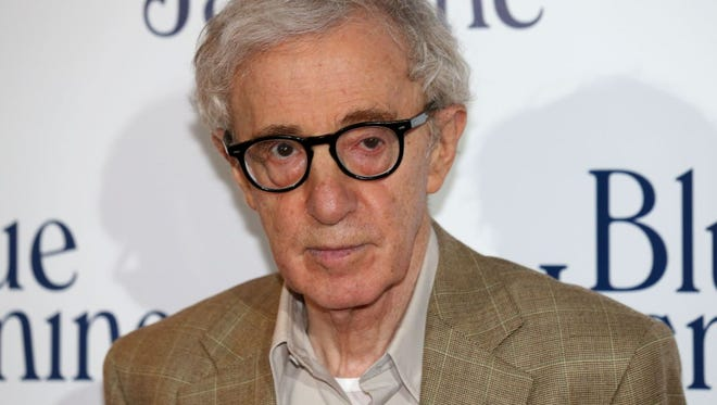 """This 2013 file photo shows film director Woody Allen posing during a photocall for the French Premiere screening of """"Blue Jasmine."""""""