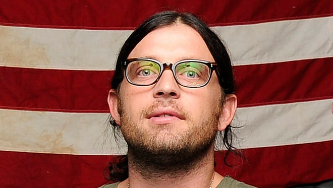 Nathan  Followill was injured in a tour bus accident over the weekend, forcing the band to postpone a Sunday show in New York. Followill broke his ribs when the bandís tour bus driver was forced to stop short when a pedestrian crossed the street in front of the vehicle Saturday, Aug. 9, 2014, after their show in Boston. (Photo by Donn Jones/Invision/AP, File) ORG XMIT: NYET155