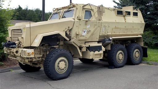 A Mine-Resistant Ambush Protected vehicle sits in front of police headquarters in 2014 in Watertown, Conn.