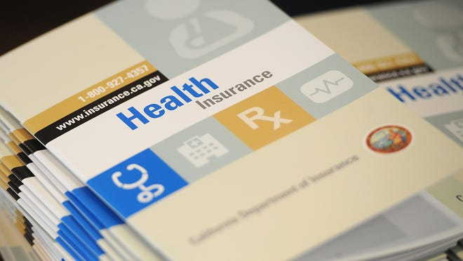 """Booklets outlining health insurance options for Californians is seen at a Senior Information & Resource Fair in South Gate, California September 10, 2013 . The event included a discussion of how the Affordable Care Act, also called """"Obamacare"""" will impact senior citizens and what insurance plans will be available to them.  With just weeks until a centerpiece of the health care reform law launches, the task of spreading the word about new health insurance marketplaces will fall to local navigators and counselors employed locally but funded by federal grant money.    AFP PHOTO / Robyn Beck        (Photo credit should read ROBYN BECK/AFP/Getty Images)"""