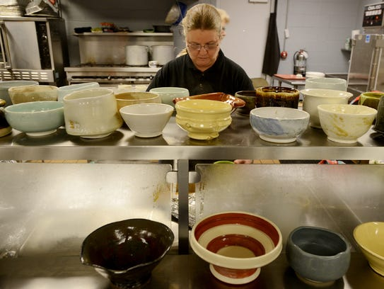 Susan McFarland prepares bowls of soup during RIFA's