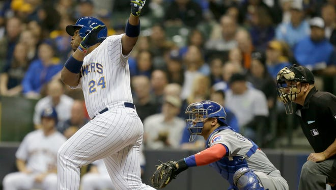 Brewers first baseman Jesús Aguilar singles in the fourth inning Friday night against the Cubs.
