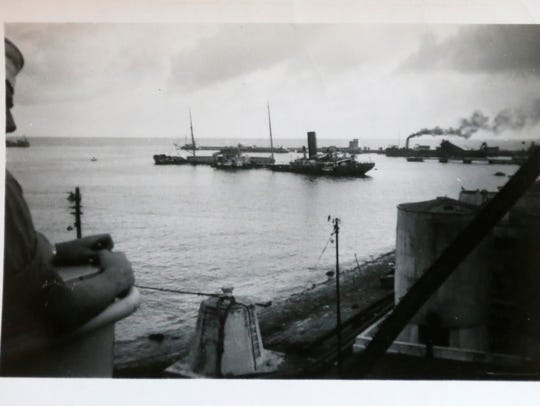 This photograph shows a sunken ship in Gibraltar Bay