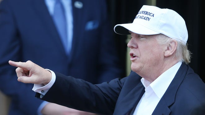 Republican presidential candiadte Donald Trump speaks as he arrives June 24 at his revamped Trump Turnberry golf course in Turnberry Scotland.