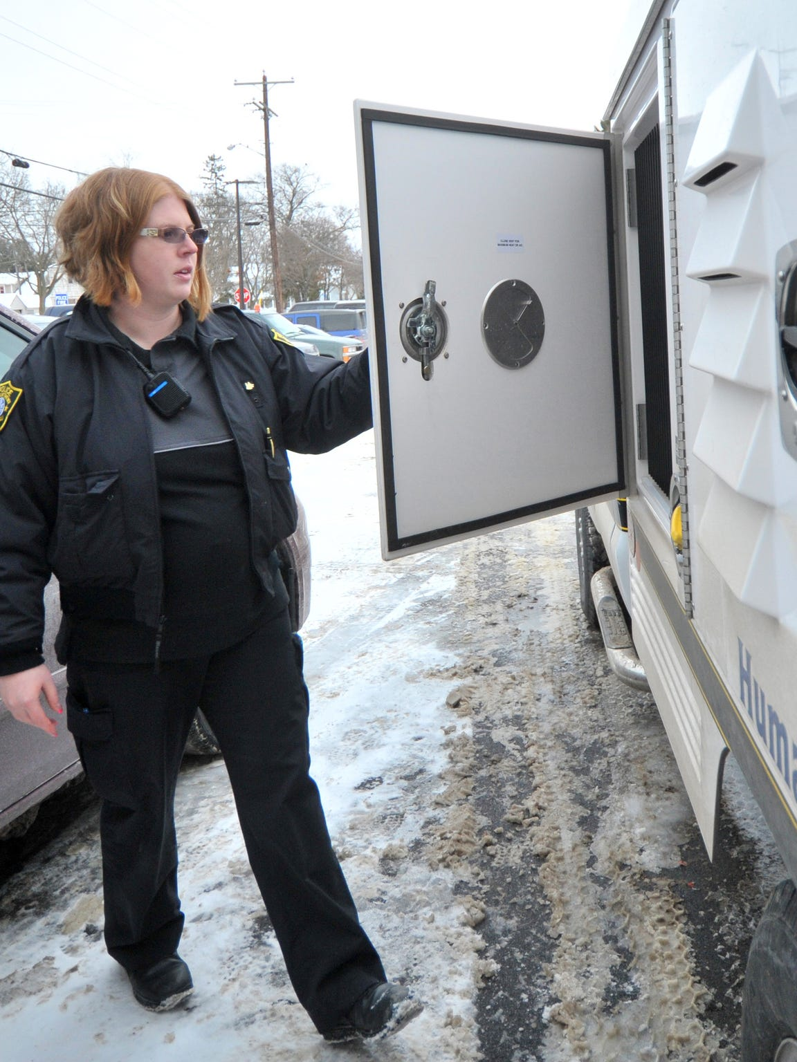 Humane officer Ashlee Bishop, 26, of Wausau, opens