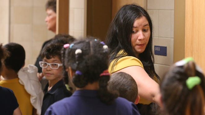 Yanelys Ortega leads her class to their lunch time at School 17 on Orchard Street in Rochester Thursday, April 27, 2017.