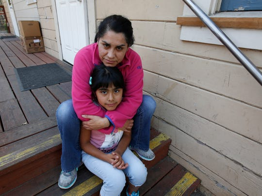 Wilma Illanes and her daughter Gabriela Cervantes pose Oct. 18, 2017, in Sonoma. Illanes and her family had to evacuate from there home as a massive wildfire swept through the area. While their home was sparred, Illanes, who is a baby sitter, and her husband, who is a landscaper, were both out of work for a work causing them to seek assistance due to the hardship.