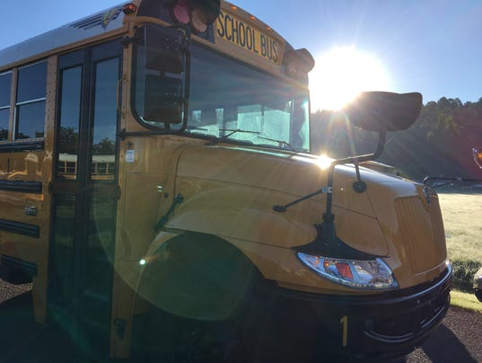 School bus drivers rose early Monday morning to get students to class ...