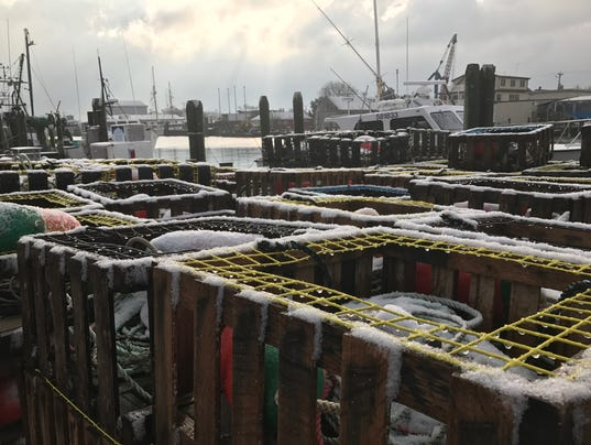 Frost and a dusting of snow sits at the west ocean city marina after a