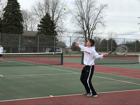 Pleasant boys tennis Dane Williams serve doubles